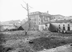 """15 Dec 1947, Berlin, Germany — Russians Blow up Hitler's """"Tombstone."""" Berlin, Germany: Sightseers walk amid the ruins of Hitler's air raid shelter, sometimes referred to as Hitler's """"tombstone,"""" after a detachment of Russian Army engineers blew it up, December 11. The ventilating tower of the shelter (cylinder with conical top) is at right. Stones from the shattered bunker, where Hitler and his mistress, Eva Braun, reportedly committed suicide, spattered the broken walls of the…"""