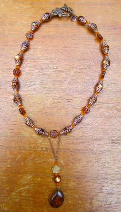 Vintage Inspired Bronze, Glass, and Crystal Beaded Drop Necklace. $15.00, via Etsy.