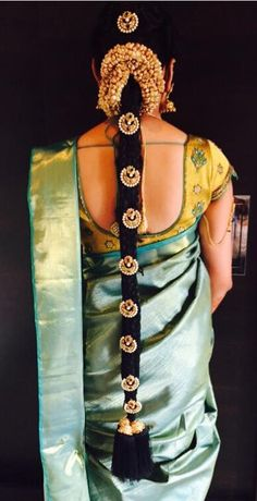 South Indian bride. Temple jewelry. Jhumkis.Light green silk kanchipuram sari.Braid with fresh flowers. Tamil bride. Telugu bride. Kannada bride. Hindu bride. Malayalee bride.