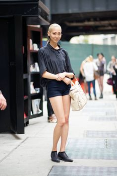 New York Fashion Week Street Style Day 1  Soo Joo Park  booty shorts + baggy collared tee + booties = chic easy combo