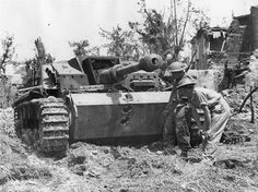 British soldiers look at the holes in the frontal armor of a German self-propelled gun StuG III ausf G. This self-propelled gun, belonging to the 907th Brigade of assault weapons - Stg.Brig.907, was knocked out by gunners of the British 64th anti-tank regiment near Aquino, Italy, May 18, 1944. #tanks #worldwar2