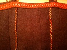 the back of my aprondress  a dear friend of mine has made the decorative woven and braided fabrics