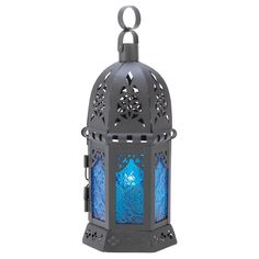 Ocean Blue Candle Lantern - Like the deepest depths of the ocean the azure blues of this candle lamp cast an enchanting aura of peace and tranquility. Simply place a votive inside to create an entrancing glow!