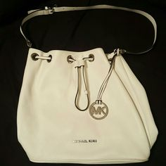 **BLACK FRIDAY SPECIAL** Gently used authentic  Michael Kors Large Jules Drawstring Handbag. White in color. Long strap. Gorgeous purse! No stains. Excellent condition. Michael Kors Bags Shoulder Bags