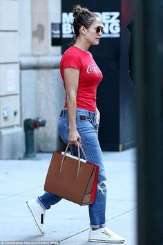 Jennifer Lopez wearing Gucci Boyfriend Straight Leg Jeans, Christian Louboutin Paloma Large Noisette Tote Bag, Roger Vivier Sneaky Viv Zip Sneakers and Topshop Coca Cola Graphic Tee #rogerviviersneakers