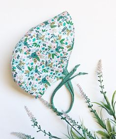 months, Reversible Sun Bonnet, Teal Floral/Teal by babyBbasic on Etsy Nape Of Neck, Pom Pom Hat, Teal, Sun, Floral, How To Make, Flowers, Flower, Turquoise