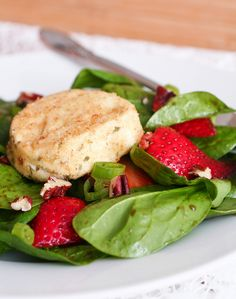 spinach strawberry salad with baked goat cheese ---> O'Courter: I made this for Valentine's Day to go with Monte Cristo sandwiches. Fresh and light yet decadent. A few changes: I didn't bake the goat cheese; just sliced and crumbled it. I used Dijon mustard instead of dried and pearl onions instead of green onions because that's what I had on hand.