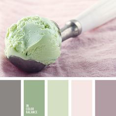 Texture of pistachio ice cream on a background of purple powder and washed gray…