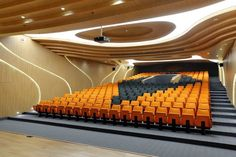 The natural tone of the wood has the highly contemporary grey and orange seats as a complement with a V layout to evoke the logo of the company.