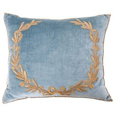 Antique European raised gold metallic embroidery of a neoclassical wreath with a bow on Wedgewood blue velvet. Hand trimmed with vintage gold cording knotted in the corners. Down filled. | B. Viz Design | bviz.com