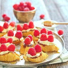Raspberry & Honey Goat Cheese Bruschetta. This beautiful and simple holiday appetizer is delicious and easy!