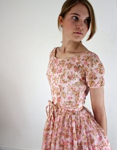 Vintage 1950s cocktail party dress with full skirt in floral print. Click to see full view.