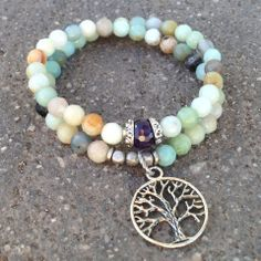 54 bead mala bracelet. Made with genuine high quality multi tone amazonite gemstones, amethyst guru bead for healing, and a Tree of life charm.  Amethyst is purple quartz, and is a meditative and calming stone. It works in the emotional, spiritual, and physical planes to provide calm, balance, patience, and peace. Amazonite is associated with the Heart and Throat Chakras. It dispels negative energy and improves confidence, leadership and communication.