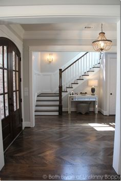 Foyer with herringbone pattern in hardwoods. 2015 Birmingham Parade of Homes built by Murphy Home Builders