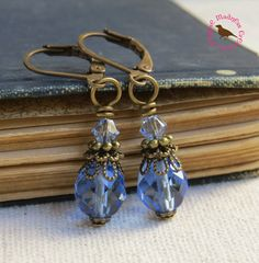 Check out this item in my Etsy shop https://www.etsy.com/listing/227596519/sapphire-drop-earrings-blue-vintage