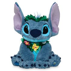 Add our totally tropical Stitch plush to your ohana for extraterrestial hugs and fun. Crowned with a ring of lovely leaves and a matching lei, Experiment 626 also sports an embroidered ''Disney store Hawaii'' on the bottom of his foot. Disney Plush, Disney Toys, Disney Mickey Mouse, Pluto Disney, Disney Land, Disney Disney, Disney Movies, Ohana, Lilo Y Stitch