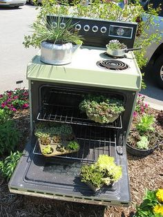 Cooking up garden goodies ~ Neat planter ideas.  Not sure I would want the cook stove in my front yard thou :)
