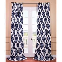 Add interest and drama to almost any room in your home with this cotton curtain panel. In addition to its eye-catching, stylized damask pattern and bold color, this lined window treatment features a weighted hem that enhances its drape.
