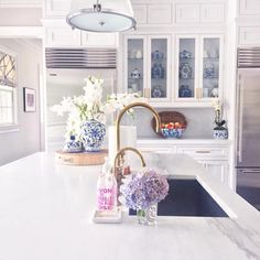 """Sue De Chiara   The Zhush on Instagram: """"Throw back to the best photo I ever took of my kitchen (only took 37 tries) at the end of last summer - so good I made it a part of my celebrate summer home tour earlier this week on the blog. I've tagged all the other beautiful accounts that participated and linked as many products as I could here--> http://liketk.it/2ota7 @liketoknow.it #liketkit #kitchen #kitchendesign #blueandwhite #hydrangeas"""""""