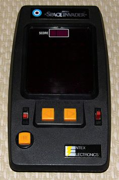 """Vintage Space Invader Handheld Electronic Game By Entex Electronics, Model 6012, Takes 6 """"AA"""" Batteries, Made In Japan, Copyright 1980."""