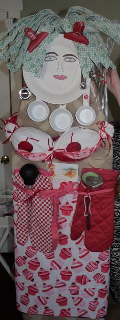 Shower gift idea!!  Ironing board with kitchen items attached to make an ironing board lady.