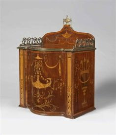 A LATE 18TH CENTURY SHERATON PERIOD CARTONNIER, England, circa 1795  The elaborate inlay with pelted Samburg birds holding pendant bell flowers on central serpentine door, opening to reveal eight cedar-lined drawers with flame mahogany veneers. Secret locking mechanism hidden behind inlaid pilaster, with grapevines, classical urns with lion's head handles inlaid on each side and the back finished with an enlarged pelt motif
