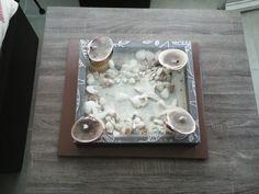 Centro de mesa hecho con conchitas de mar