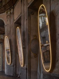 """""""Flos turned on the light around the mirror and Snow White appeared,"""" says designer Philippe Starck of La Plus Belle, his LED-wrapped mirror for Flos."""