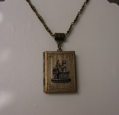 This little antique bronze locket necklace has a locket pendant made to look like a fairy tale book. The pendant is antique bronze and the