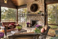A beautifully furnished screened porch, with a fireplace, in the woods? Yes, please.