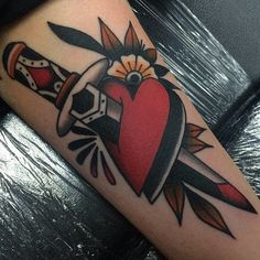 What does heart and dagger tattoo mean? We have heart and dagger tattoo ideas, designs, symbolism and we explain the meaning behind the tattoo. Traditional Tattoo Heart And Dagger, Traditional Tattoo Art, Pin Up Tattoos, Trendy Tattoos, Cool Tattoos, Tatoos, Crazy Tattoos, Small Tattoos, Blade Tattoo