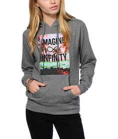 """Explore all new style dimensions with this soft and comfortable fleece hoodie that features a galaxy beach graphic with """"Imagine Infinity"""" lettering."""