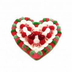 Cœur en bonbons. L'amour en gourmandise, ce cœur est créé avec des fraises, des soucoupes acidulées, des tweesty et des mures.  Ce cœur est composé d'environ 68 confiseries .
