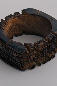 """Wooden bracelet with hand-sawn cut texture  Width measures 1 1/2"""" Inner diameter measures 2 1/2""""   Hand-sawn Wooden Bracelet      $100.00  our of stock"""