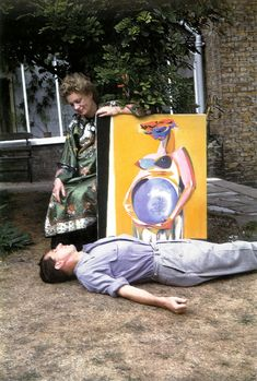 Lee Miller and Roland Penrose with painting, First View, 36 Downshire Hill, London, 1947
