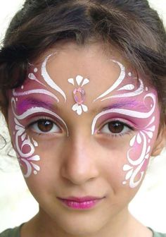 Embellished mask facepaint - looks like a soft sponged base color and white over the top.  Love the jewel. :)