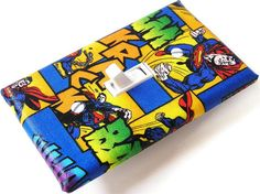 SUPERMAN Switchplate Light Switch Plate Outlet Cover - Bue Red Yellow. $8.00, via Etsy.