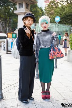 Shoko (on the left in a blazer and wide leg pants) and Rena (on the right with houndstooth, aqua hair & a Vivienne Westwood bag) - both with stretched ears - on the street in Harajuku.