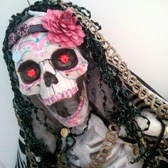 I would think this would be pretty easy to do. Buy some paint to paint the face, some lace for the veil, a fake flower from the dollar store sewn in some lace headband and a red little balls for the eyeballs!