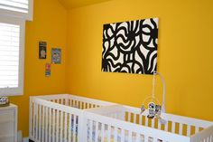 #Orange #nursery with graphic black and white accents.  #blackandwhite