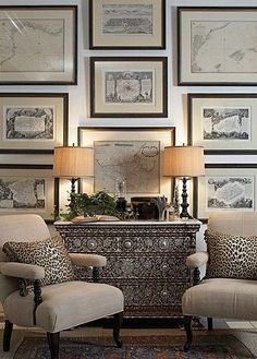 I like the look with the stunning Syrian dresser with the black and while antique framed prints on the wall with the club chairs in neutral fabric.