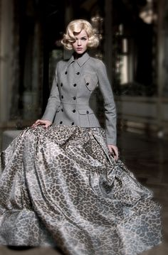 Love the skirt, but not with that jacket. I could see it with a gray cowl-necked chiffon blouse and a bronze gold cummerbund....and matching bronze gold sandal heels.