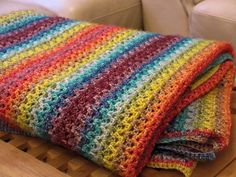 Blij dat ik brei: Warm, kleurig dekentje / Warm, colorful blanket, page is in Dutch with V-Stitch crochet diagram and links.