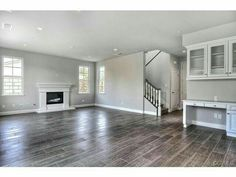 big and open, tile wood floor, BUILT IN DESK right in living room. love it. big and open, tile wood floor, BUILT IN DESK right in living room. love it. Grey Wood Tile, Grey Wood Floors, Wood Tile Floors, Grey Flooring, Wood Planks, Wood Look Tile Floor, Wood Floor Colors, Penny Flooring, Wood Plank Tile