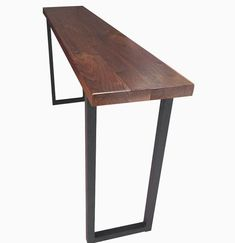 "This walnut and steel breakfast bar or console table would be a beautiful addition to any room! Shown at 70"" Long X 12"" Wide X 36"" Tall, the top is 1.75"" thick solid black walnut, complimented with tu"
