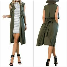 "NEW  Military Green Duster Vest  Duster vest in military green features big lapels, waist tie, and two front pockets. 43"" in total length. Brand new. Cotton-poly blend. 10% spandex. Boutique Jackets & Coats Vests"
