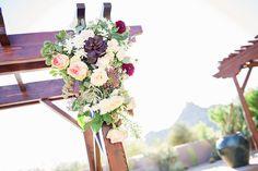 Plum Pink + Gold Arizona Wedding: Wedding arch with romantic fall flowers. Jessica Q Photography