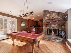 Nice game room and fireplace.