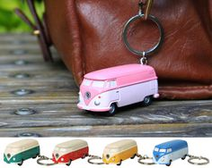Volkswagen Bus Led Key Chain and more Fun Gift Ideas at Perpetual Kid. The Volkswagen Type affectionately known as the VW Bus or VW Microbus, has been in con Volkswagen Bus, Kombi Camper, Vw T1, Campervan, Vw Accessories, Cool Keychains, Vw Cars, Stocking Stuffers, Computer Hardware