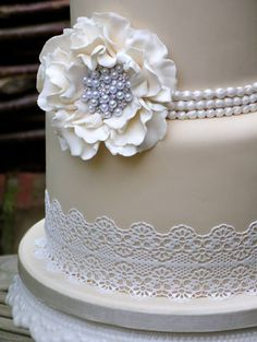 Stunning wedding cake with pearl & lace accents
